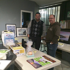 Cesar and Marc and the silent auction items